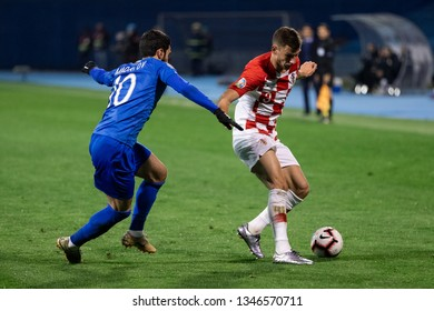 ZAGREB, CROATIA - MARCH 21, 2019: UEFA EURO 2020 Qualifying round, Group E. Croatia VS Azerbaijan. Borna BARISIC (3) and Mahir MADATOV (10)