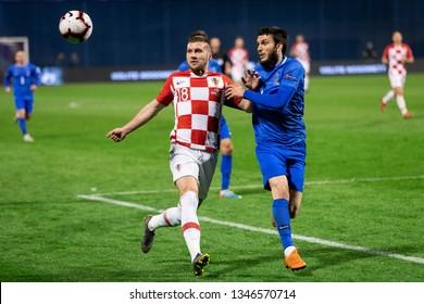ZAGREB, CROATIA - MARCH 21, 2019: UEFA EURO 2020 Qualifying round, Group E. Croatia VS Azerbaijan. Ante REBIC (18) and Badavi HUSEYNOV (6)