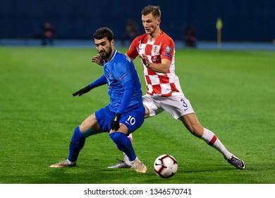 ZAGREB, CROATIA - MARCH 21, 2019: UEFA EURO 2020 Qualifying round, Group E. Croatia VS Azerbaijan. Mahir MADATOV (10) and Borna BARISIC (3)