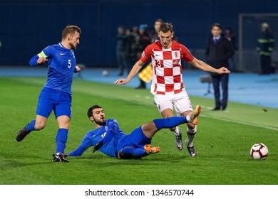 ZAGREB, CROATIA - MARCH 21, 2019: UEFA EURO 2020 Qualifying round, Group E. Croatia VS Azerbaijan. Borna BARISIC (3), Mahir MADATOV (10) and Maksim MEDVEDEV (5)