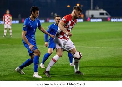 ZAGREB, CROATIA - MARCH 21, 2019: UEFA EURO 2020 Qualifying round, Group E. Croatia VS Azerbaijan. Bruno PETKOVIC (20) and Rahil MAMMADOV (4)