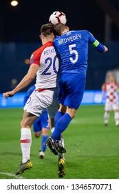 ZAGREB, CROATIA - MARCH 21, 2019: UEFA EURO 2020 Qualifying round, Group E. Croatia VS Azerbaijan. Bruno PETKOVIC (20) and Maksim MEDVEDEV (5)