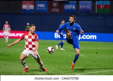 ZAGREB, CROATIA - MARCH 21, 2019: UEFA EURO 2020 Qualifying round, Group E. Croatia VS Azerbaijan. Nikola VLASIC (13) and Badavi HUSEYNOV (6)