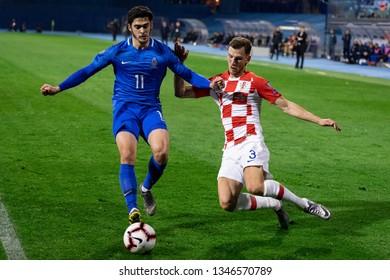ZAGREB, CROATIA - MARCH 21, 2019: UEFA EURO 2020 Qualifying round, Group E. Croatia VS Azerbaijan. Borna BARISIC (3) and Ramil SHEYDAEV (11)
