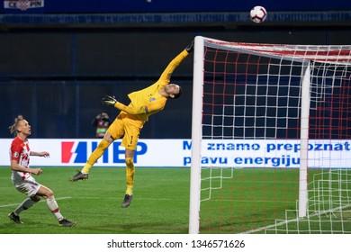 ZAGREB, CROATIA - MARCH 21, 2019: UEFA EURO 2020 Qualifying round, Group E. Croatia VS Azerbaijan. Domagoj VIDA (21) and Salahat AGAYEV (1)