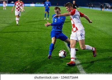 ZAGREB, CROATIA - MARCH 21, 2019: UEFA EURO 2020 Qualifying round, Group E. Croatia VS Azerbaijan. Andrej KRAMARIC (9) and Maksim MEDVEDEV (5)
