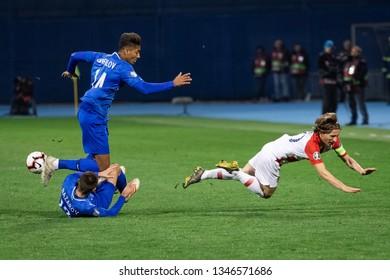 ZAGREB, CROATIA - MARCH 21, 2019: UEFA EURO 2020 Qualifying round, Group E. Croatia VS Azerbaijan. Luka MODRIC (10), EDDY (14) and Dmitri NAZAROV (13)