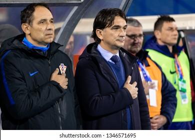 ZAGREB, CROATIA - MARCH 21, 2019: UEFA EURO 2020 Qualifying round, Group E. Croatia VS Azerbaijan. Croatian Head-coach Zlatko DALIC (right) and coach Drazen LADIC (left) during national anthem.