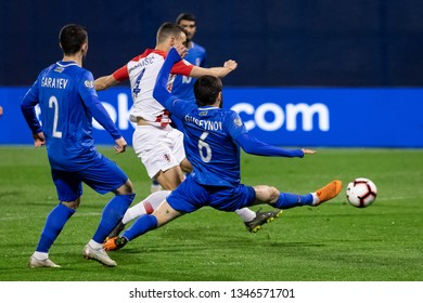 ZAGREB, CROATIA - MARCH 21, 2019: UEFA EURO 2020 Qualifying round, Group E. Croatia VS Azerbaijan. Ivan PERISIC (4), Badavi HUSEYNOV (6) and Gara GARAYEV (2)