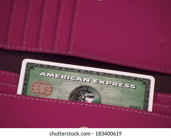 ZAGREB, CROATIA - MARCH 22, 2014: Photo of green American express card in wallet. American express is one of most popular credit cards worldwide.