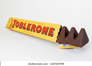 ZAGREB, CROATIA - MARCH 23, 2019: Toblerone Swiss Milk Chocolate with Honey and Almond Nougat on white background. Toblerone was created by Emil Baumann & Theodor Tobler in Bern, Switzerland, in 1908.