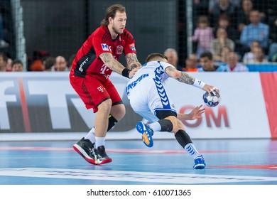 ZAGREB, CROATIA - MARCH 25, 2017: EHF Men's Champions League 2016-17, Final 16. HC Zagreb PPD VS HC Veszprem. Andreas NILSSON (18) holding Domagoj PAVLOVIC (94)