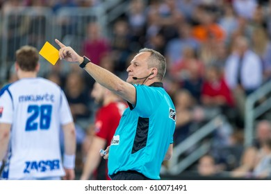 ZAGREB, CROATIA - MARCH 25, 2017: EHF Men's Champions League 2016-17, Final 16. HC Zagreb PPD VS HC Veszprem. Referee showing yellow card.