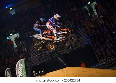 ZAGREB, CROATIA - MARCH 30, 2013: Quad driver performing on Masters of dirt 2013 - Freestyle motocross show.
