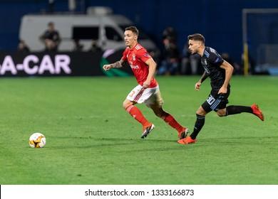 ZAGREB, CROATIA – MARCH 7, 2019: UEFA Europa League 2018/2019, Round of 16, 1st leg. GNK Dinamo Zagreb VS S.L. Benfica. Alex GRIMALDO (3) and Petar STOJANOVIC (30)