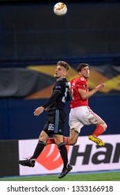 ZAGREB, CROATIA – MARCH 7, 2019: UEFA Europa League 2018/2019, Round of 16, 1st leg. GNK Dinamo Zagreb VS S.L. Benfica. Emir DILAVER (66) and Ruben DIAS (6)