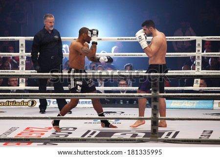ZAGREB, CROATIA - MARCH 8, 2014: Glory 14, kickboxing event. Sahak PARPARYAN (white gloves) VS Jason WILNIS (black gloves)
