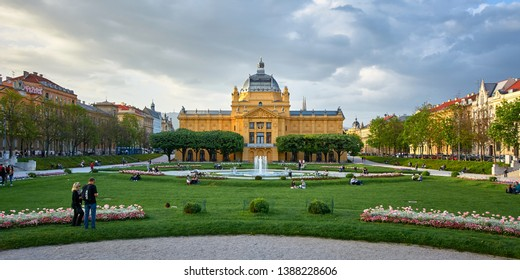 Zagreb, Croatia - May 01 2019: People enjoying in nice spring day in park Art pavilion in colorful park, in Zagreb, capital of Croatia