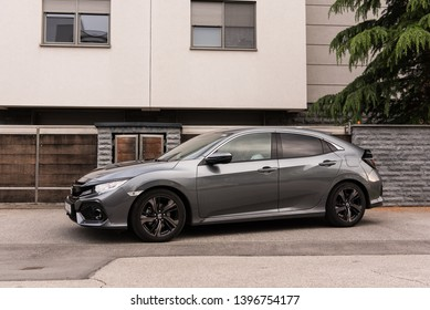 ZAGREB, CROATIA - MAY 12, 2019: New Honda Civic in grey colour in front of the house. New Honda model. Side view of the car.