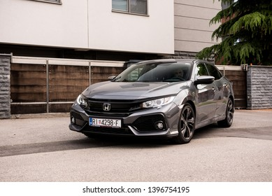 ZAGREB, CROATIA - MAY 12, 2019: New Honda Civic in grey colour in front of the house. New Honda model. Front view of the Honda civic.