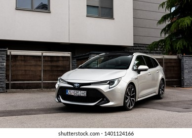 ZAGREB, CROATIA - MAY 12, 2019: New Toyota Corolla, 2019 model in urban environment. Parked car in front of the house.