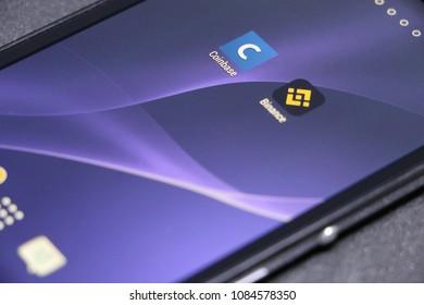 ZAGREB, CROATIA - MAY , 2018: Coinbase and binance android app icon. Blue wallpaper.