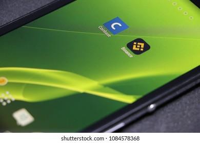 ZAGREB, CROATIA - MAY , 2018: Coinbase and binance android app icon. Green wallpaper.