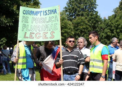 ZAGREB, CROATIA - MAY 21, 2016 :  Protesters march with signs raised through Zagreb in a protest against US biotechnology group Monsanto and against TTIP agreement.