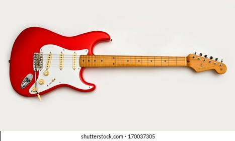 ZAGREB , CROATIA - MAY 27, 2010 : Red Fender stratocaster guitar on white background , product shot
