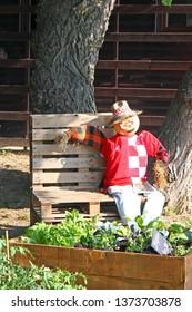 ZAGREB, CROATIA - MAY 29, 2018: A straw man resting on garden bench, garden sculpture, Floraart 53. International Garden Exhibition, Zagreb, Croatia
