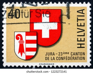 ZAGREB, CROATIA - NOVEMBER 1, 2018: a stamp printed in Switzerland shows Arms of Switzerland and Jura, Admission of Jura as 23rd Canton, circa 1978