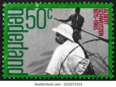 ZAGREB, CROATIA - NOVEMBER 1, 2018: a stamp printed in Netherlands shows Albert Schweitzer (1875-1065) in boat, medicinal missionary, circa 1975