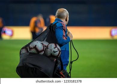ZAGREB, CROATIA - NOVEMBER 15, 2018: UEFA Nations League football match Croatia vs. Spain. Man caring the practise balls