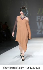 ZAGREB, CROATIA - NOVEMBER 22: Fashion model wearing clothes designed by Iggy Popovic on the Zagreb Fashion Week show on November 22, 2013 in Zagreb, Croatia.