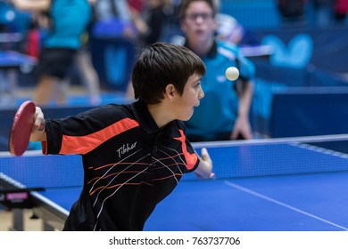 ZAGREB, CROATIA - NOVEMBER 25, 2017: Table tennis international memorial  Antun Tova Stipancic. Kid player serves the ball