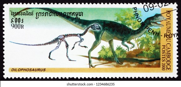 ZAGREB, CROATIA - NOVEMBER 3, 2018: a stamp printed in Cambodia shows dilophosaurus, is a theropod dinosaur that lived during the early Jurrasic, circa 2000