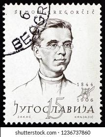ZAGREB, CROATIA - NOVEMBER 3, 2018: a stamp printed in Yugoslavia shows Simon Gregorcic (1844-1906), was a Slovene poet and Roman Catholic priest, circa 1957