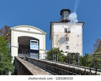 ZAGREB, CROATIA - OCTOBER 10, 2018: Daily cannon shot at noon from the Lotrscak tower. The tower dates to the 13th century. The cannon is fired from the tower to mark midday since January 1, 1877.