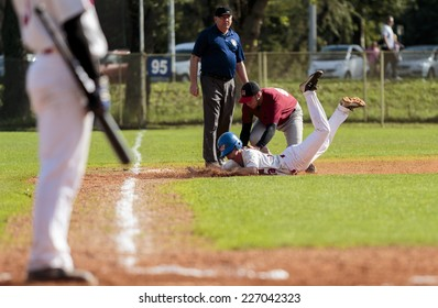 ZAGREB. CROATIA - OCTOBER 11, 2014: Match between Baseball Club Zagreb in white jersey and Medvednica in red jersey. Unidentified player throw himself on the base