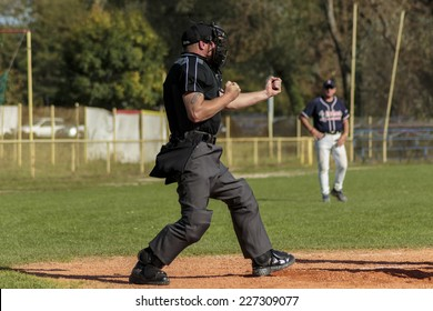 ZAGREB. CROATIA - OCTOBER 12, 2014: Match between Baseball Club Zagreb in blue jersey and Olimpija in dark blue jersey. Plate umpire indicates out with specific hand gesticulation