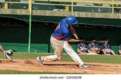 ZAGREB. CROATIA - OCTOBER 12, 2014: Match between Baseball Club Zagreb in blue jersey and Olimpija in dark blue jersey. Unidentified batter miss the ball