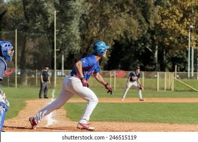 ZAGREB. CROATIA - OCTOBER 12, 2014: Match between Baseball Club Zagreb in blue jersey and Olimpija in dark blue jersey. Unidentified runner on field