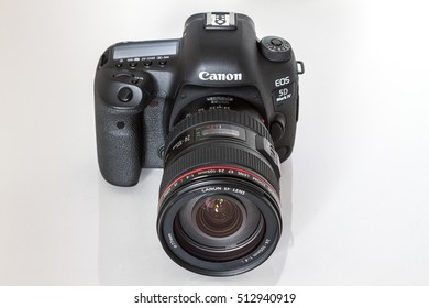 ZAGREB, CROATIA - October 14, 2016: Canon 5D Mark IV camera with Canon EF 27-70mm f/2.8L II USM lens on a white background. Canon is the world largest SLR camera manufacturer.