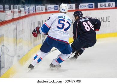 ZAGREB, CROATIA - OCTOBER 23, 2016: KHL league 2016/2017- Medvescak Zagreb VS Lada Togliatti. Alexander BOLSHAKOV (57) and Brandon MCMILLAN (88).