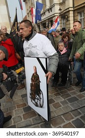 ZAGREB, CROATIA - OCTOBER 30, 2014: Croatian Independence war veterans protester holding the photo of wheelchair-bound female ex-soldier who reportedly died from exhaustion at a rally.