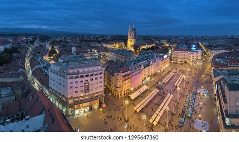 ZAGREB, CROATIA - OCTOBER 7, 2018: Panoramic view of the historical part of the city with Zagreb Cathedral at the Upper Town and Ban Jelacic Square at the Lower Town in dusk.