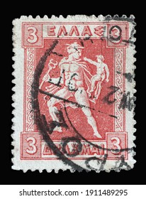 ZAGREB, CROATIA - SEPTEMBER 04, 2014: Stamp printed in Greece shows Hermes holding his little brother Arkas, Litho Hermes and Iris series, circa 1921