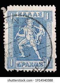 ZAGREB, CROATIA - SEPTEMBER 04, 2014: Stamp printed in Greece shows Hermes holding his little brother Arkas, Litho Hermes and Iris series, circa 1919