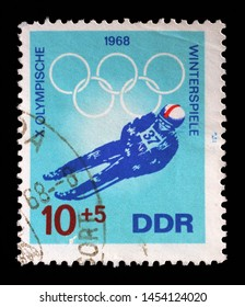 ZAGREB, CROATIA - SEPTEMBER 06, 2014: A stamp issued in Germany - Democratic Republic (DDR) shows Luge, Winter Olympics 1968 in Grenoble, circa 1968.