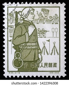 ZAGREB, CROATIA - SEPTEMBER 08, 2014: A stamp issued in the China shows Militia, the 1st Anniversary of People's Communes, circa 1959.